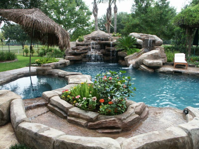 pool with waterfall slide spa creek grotto and landscape
