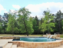 Beautiful travertine pool with unique elevation changes