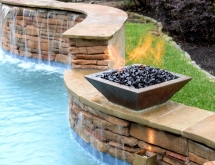 Fire Pit Placed on a Stacked Stone Weeping Wall