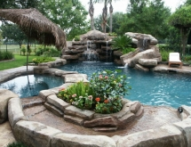 Pool with Waterfall, Slide, Spa, Creek, Grotto and Landscape