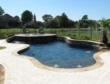 Freeform Pool with Sunshelf and Raised Wall