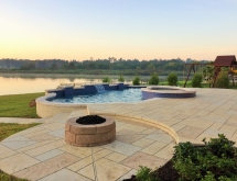 Geometric Pool with Spa, Raised Beams, Columns and a Sheer Descent. Elevation Change to Fire Pit Area.