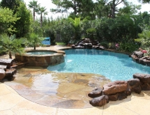 Pool with Flagstone Beach Entry and Raised Spa