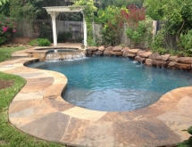Pool with Flagstone, Sunshelf and Weeping Rock Wall