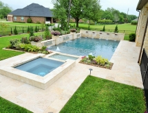 Travertine Pool and Decking. Raised Spa That Flows into a Creek That Empties into the Pool. Raised Beams Accented with Scuppers Glass Tile Ledger Stone and Planter Bowls